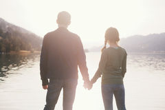 Couple holding hands near lake Stock Photography