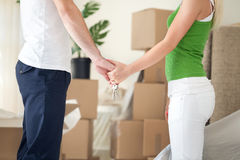 Couple holding hands in new home Stock Photo