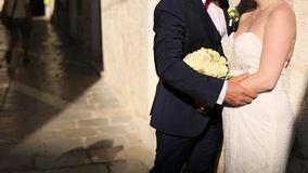 Couple holding hands in the old city. A newly married couple in stock footage