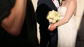 Couple holding hands in the old city. A newly married couple in stock video