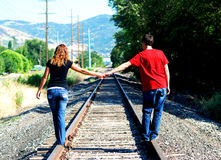 Couple Holding Hands On Railroad Royalty Free Stock Photography