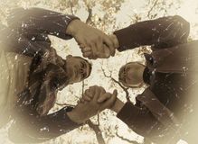 Couple holding hands over sky background, retro style Stock Images
