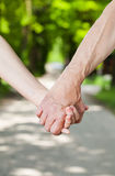 A couple holding hands Royalty Free Stock Photos