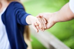 Couple Holding Hands In Park Stock Photo