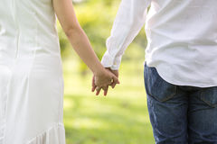 Couple holding hands in the park Royalty Free Stock Photos