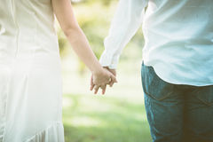 Couple holding hands in the park Royalty Free Stock Image