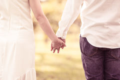 Couple holding hands in the park Royalty Free Stock Photography