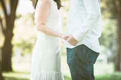 Couple holding hands in the park Royalty Free Stock Photo