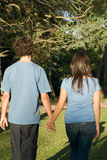 Couple Holding Hands in a Park. Vertical Royalty Free Stock Photo