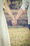 Couple holding hands in the park Stock Image