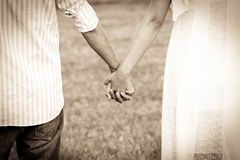 Couple holding hands in the park Stock Photos