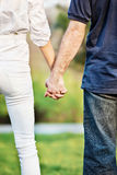 Couple holding hands in park Royalty Free Stock Image