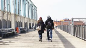 Couple holding hands on a pier in New York City. stock images