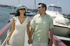 Couple Holding Hands On The Pier Stock Images