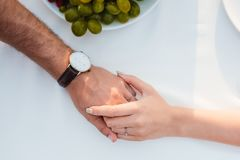 Couple holding hands after propose. In romantic date royalty free stock images