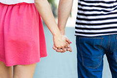 Couple holding hands, rear view Royalty Free Stock Photography