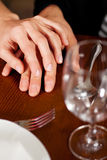 Couple holding hands on a restaurants table Royalty Free Stock Photo