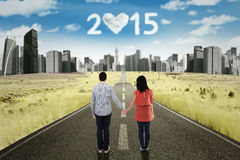 Couple holding hands on the road Stock Photos