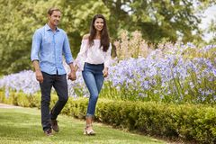 Couple Holding Hands On Romantic Walk In Park Together stock photos