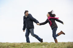 Couple Holding Hands And Running Royalty Free Stock Images