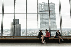 Couple holding hands sitting on the rooftop garden of the Walkie Talkie. Royalty Free Stock Photos