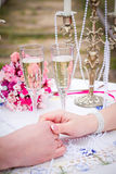 Couple holding hands at  table Royalty Free Stock Photos