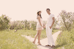 Couple  holding hands, tinted. Young couple walking in the park holding hands Stock Photography