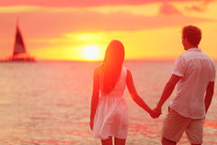 Couple holding hands together at beach sunset Royalty Free Stock Photography