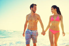 Couple holding hands together at beach sunset Royalty Free Stock Image