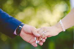 Couple holding hands together for happiness. Two hands of happy people holding stock images