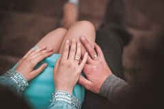 Couple holding hands together no face Royalty Free Stock Photography