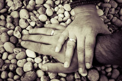 Couple holding hands together with their rings showing Royalty Free Stock Photography