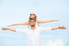 Couple holding hands up at sea side Royalty Free Stock Photo
