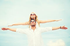 Couple holding hands up at sea side Stock Photo