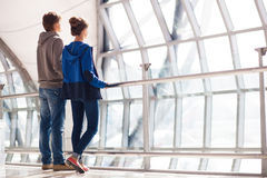 Couple holding hands and waiting at airport Stock Image