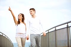 Couple Holding Hands While Walking Stock Photo