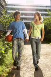 A couple holding hands and walking. Stock Photography