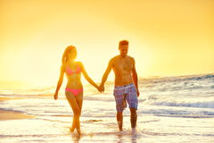 Couple Holding Hands While Walking At Beach Royalty Free Stock Image