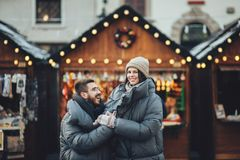 Happy couples on the city square decorated for a Christmas marke Royalty Free Stock Photography