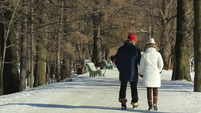 Couple are holding hands, and walking stock video footage