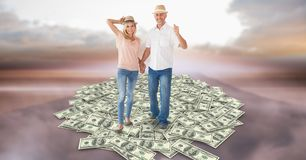 Couple holding hands while walking on money Stock Photos