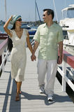 Couple Holding Hands While Walking On Pier Stock Photos
