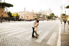 Couple holding hands walking in Rome, Italy, Europe. Casual young couple holding hands walking in Rome, Italy, Europe royalty free stock photography