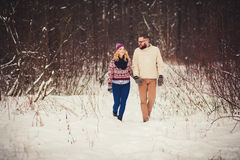 Couple holding hands walking Stock Images