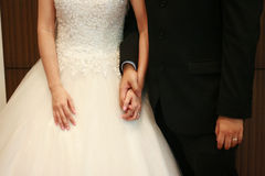 Couple holding hands. During a wedding ceremony royalty free stock image