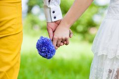 Couple holding hands. On weddings Stock Images