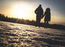 Couple holding hands in winter sunset. Lovers standing together through hard times, relationship challenges and problems. Romantic date outdoors in nature. Man Stock Photos