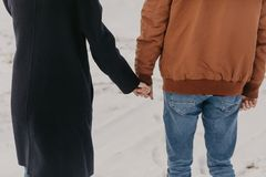 Couple holding by hands, winter time stock image