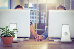 Couple holding hands at work Stock Photography