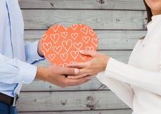 Couple holding heart shape box Royalty Free Stock Image